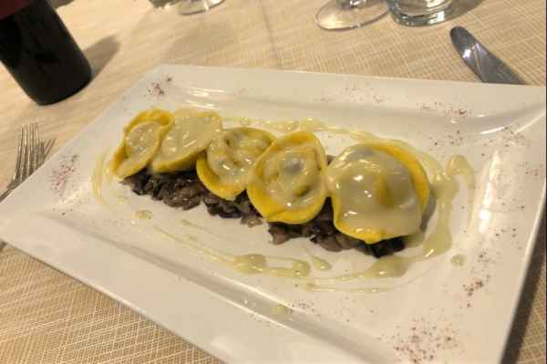 Tortelli stuffed with radicchio (red cabbage) served gorgonzola cheese and nuts